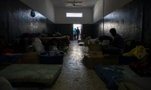 In many detention centres in Libya, people have minimal natural light and ventilation, insufficient food and clean drinking water, and a lack of hygiene facilities. Photo from 2019. © Aurelie Baumel/MSF