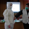 MSF staff conducts training for healthcare workers on proper use of protective equipment, infection control, flow of patients — triage, screening and isolation — as well as waste management. © Damaris Giuliana/MSF